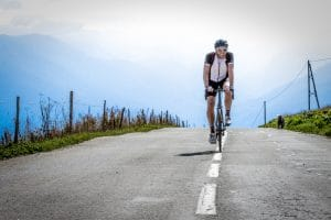 One of www.velovation.co.uk guests cresting the top of the Col de la Madeleine on their Big One Tour